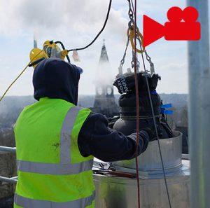 worker inspecting chimney liner